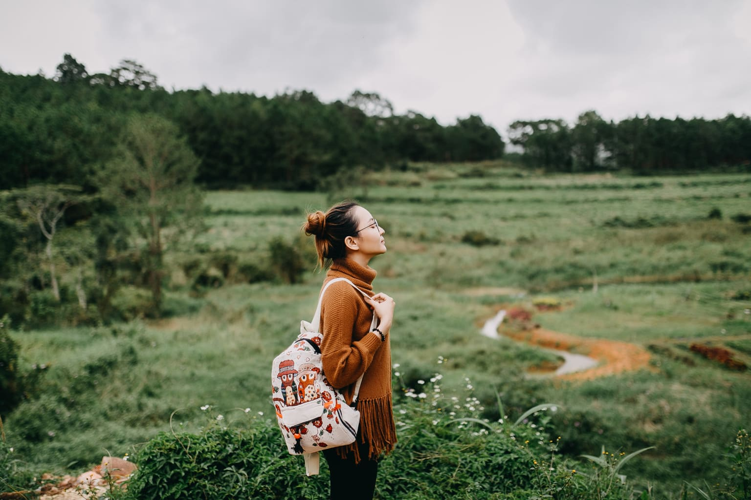 girl in nature with backpack