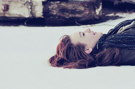 Girl lying in the snow