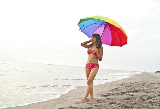 Girl on beach in swimsuit