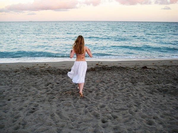 Girl wearing skirt on the beach
