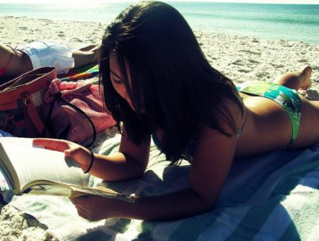 Girl reading on the beach