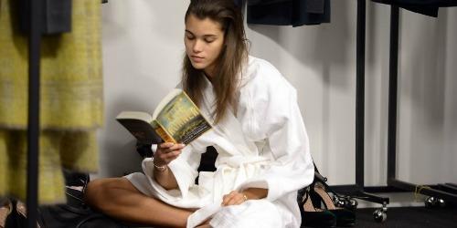 Girl reading book in a bathrobe