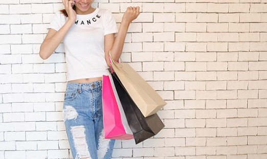Girl Smiling While Holding Shopping Bags