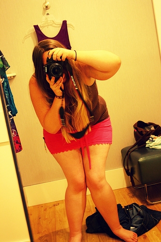 Girl taking a photo of herself in the mirror