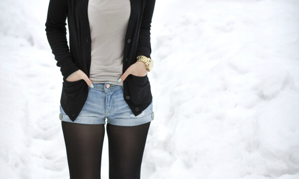 Girl wearing shorts in winter