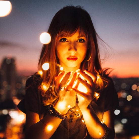 Girl holding lights
