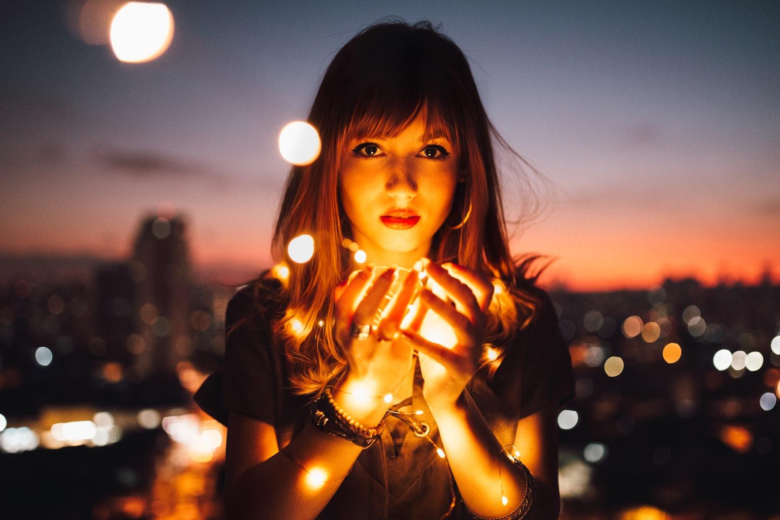 Girl holding lights