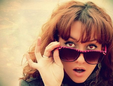 Girl with pink zebra striped sunglasses
