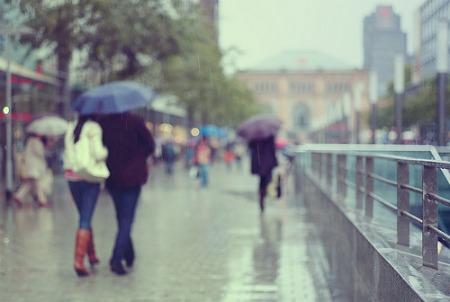girls-walking-in-rain