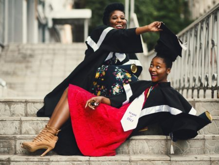 Girls with graduation caps