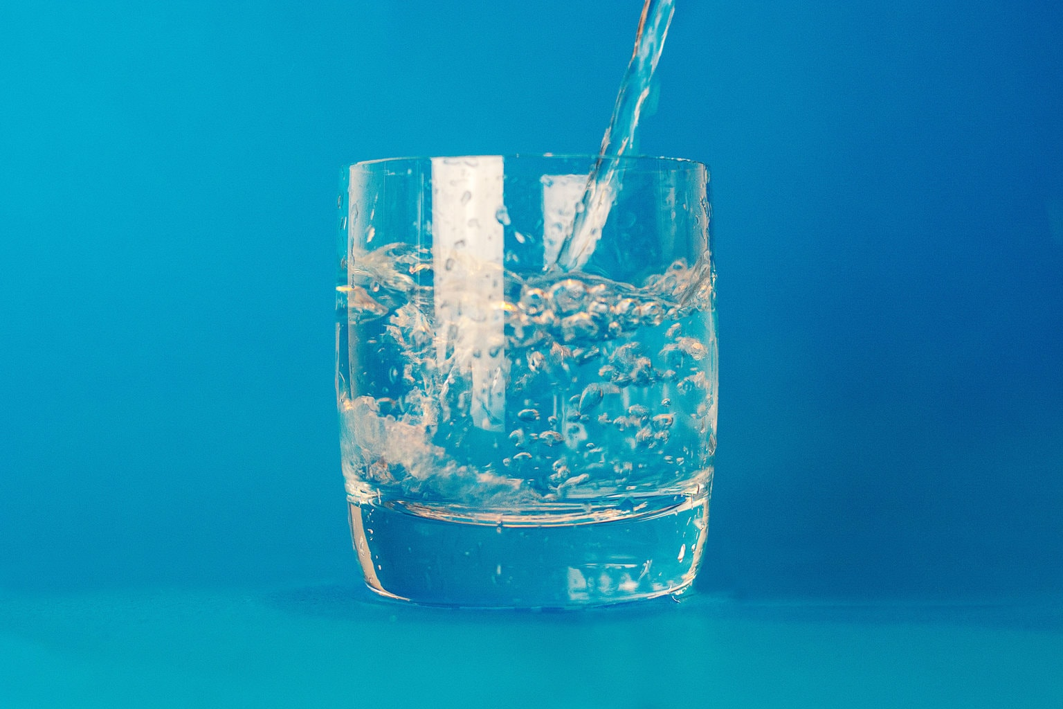 glass of water with blue background