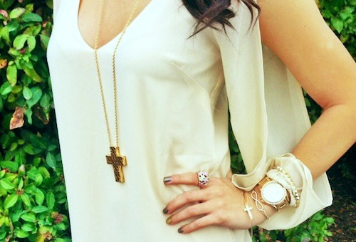 Gold jewelry paired with a white dress