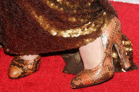 Gold sequin dress on red carpet