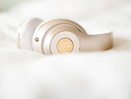 Gold wireless Beats by Dre headphones