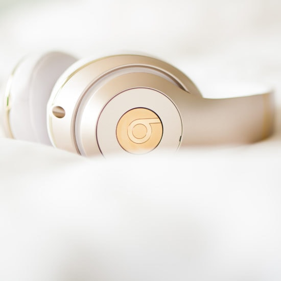Gold wireless Beats by Dre headphones