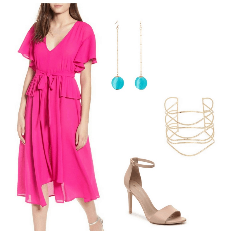 Graduation outfit idea: Bright pink dress with ruffles and cinched waist, gold bracelet, blue and gold drop earrings, nude sandals