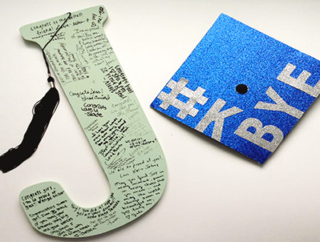 Initial letter guestbook and graduation cap