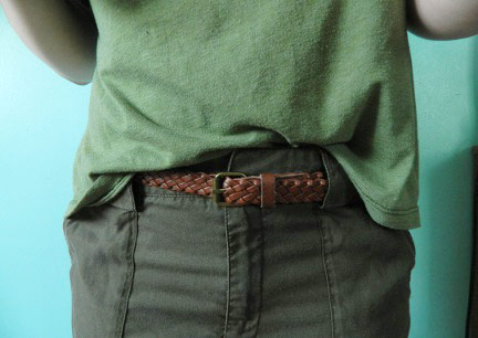 Monochrome green outfit: Green top, green pants, brown belt