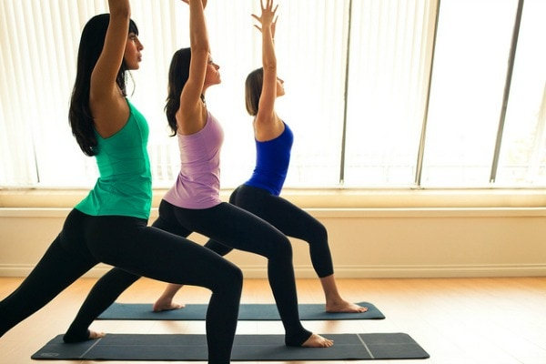 Ways for college girls to exercise - group yoga