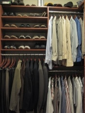 A guy's closet full of mens clothing