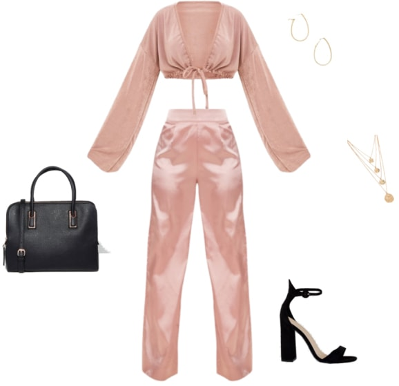 Hailey Baldwin outfit with satin top, satin pants, black strappy heels, top handle bag, gold jewelry