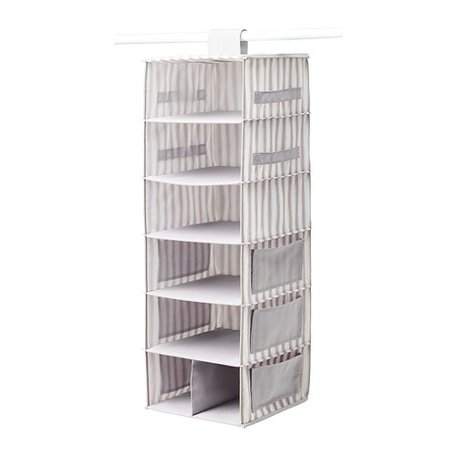 Hanging vertical closet storage organizer from IKEA with side pockets and shelves.
