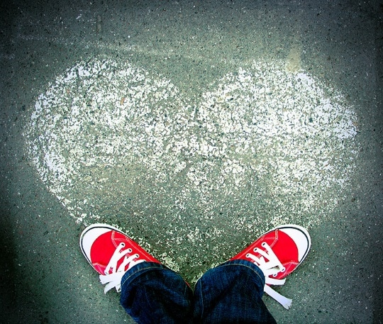 Chalk heart with red Converse shoes