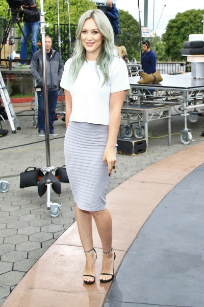 Hilary Duff in a cropped tee and pencil skirt