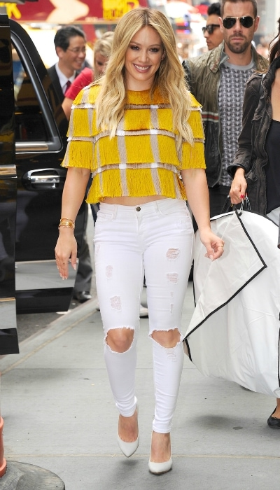 Hilary Duff in a yellow top and white jeans