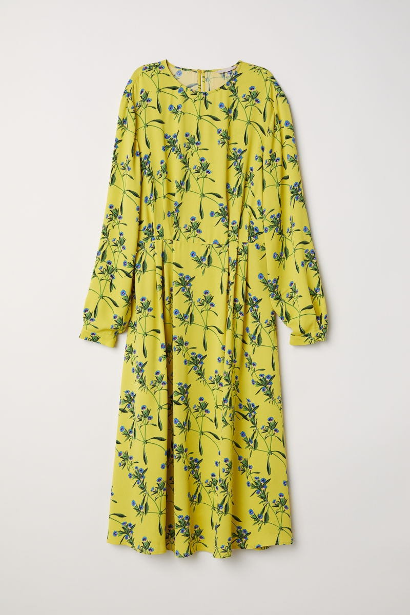 Neon yellow long-sleeved midi dress with blue and green floral pattern with small amounts of red