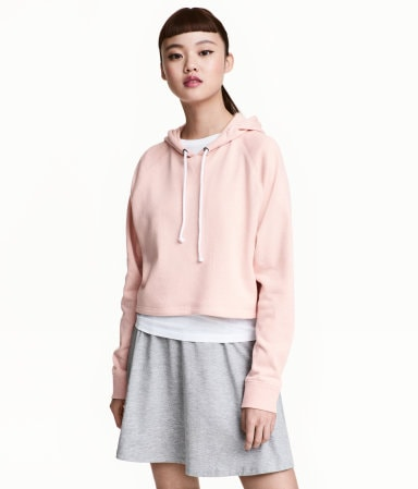woman in cropped pink hoodie