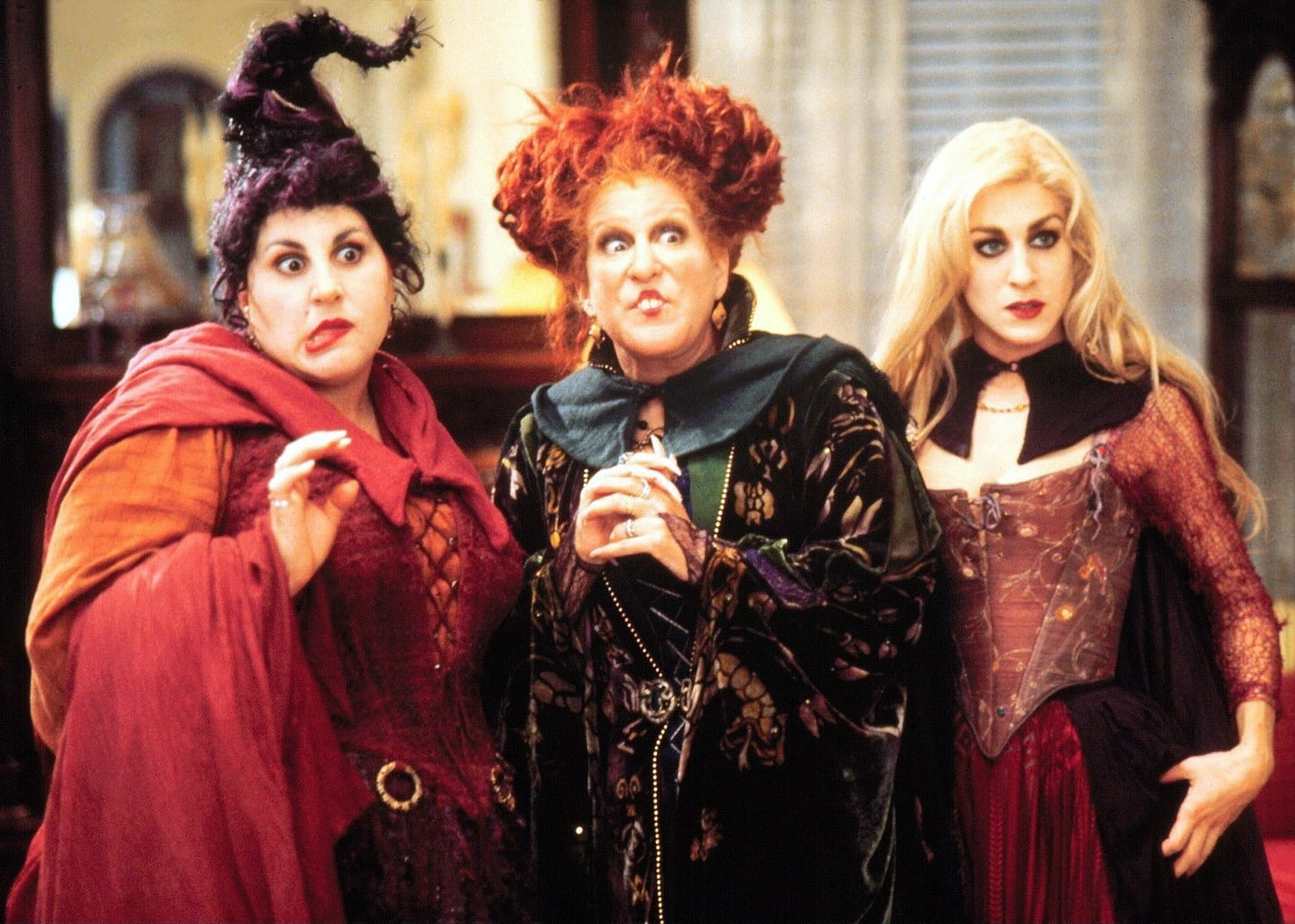 Hocus Pocus - screenshot of the Sanderson sisters dressed in their witch robes in the movie