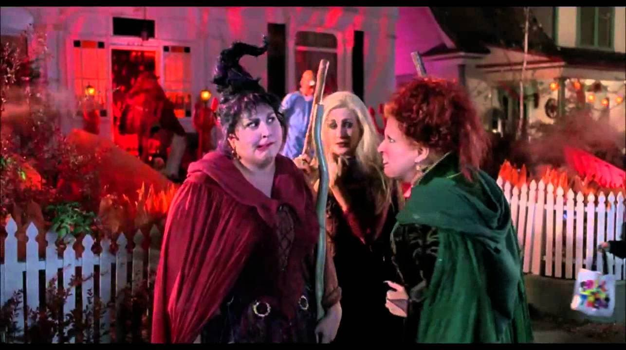 Screenshot of the Sanderson sisters outside trick or treating in Hocus Pocus