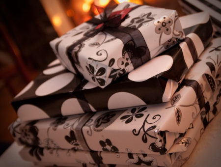 Holiday gifts wrapped in black and white paper