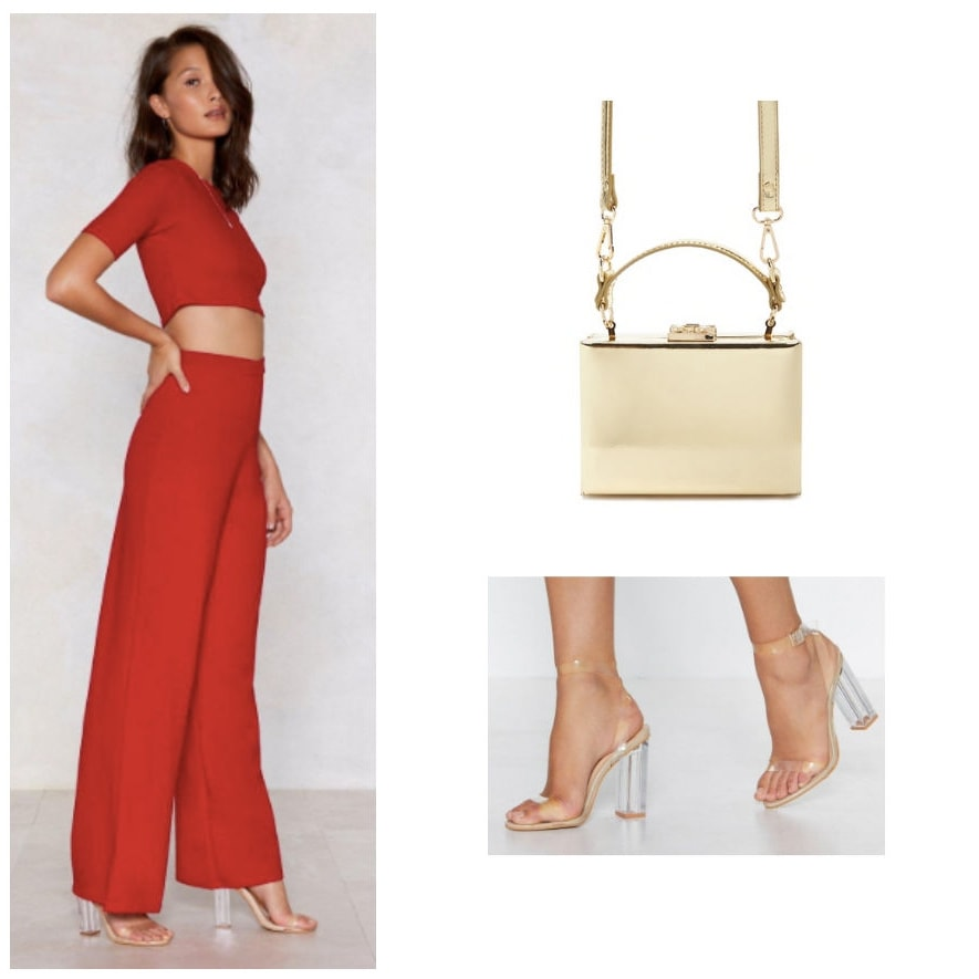 Holiday party outfit with red two piece set, gold box handbag, and perspex heels