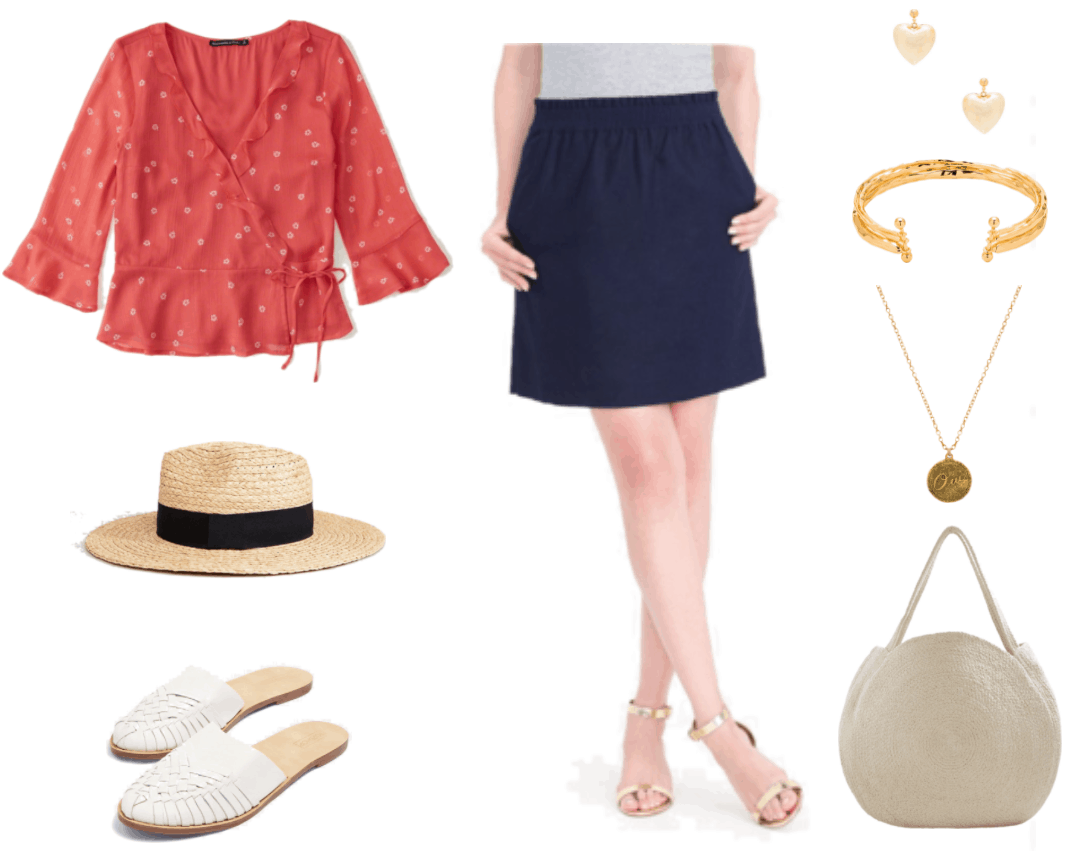 """Coral-red side-tie three-quarter-sleeve wrap top with ruffled neckline and sleeves and small white floral print, straw fedora hat with black band, white woven flat round-toe mules, high-waisted navy blue elastic-waist skirt, gold heart puff heart drop earrings, gold triple-layer hammered cuff bracelet held together with small vertical gold bars at either side with balls on either end, brass necklace with round etched """"Oui"""" pendant, light beige round woven tote"""