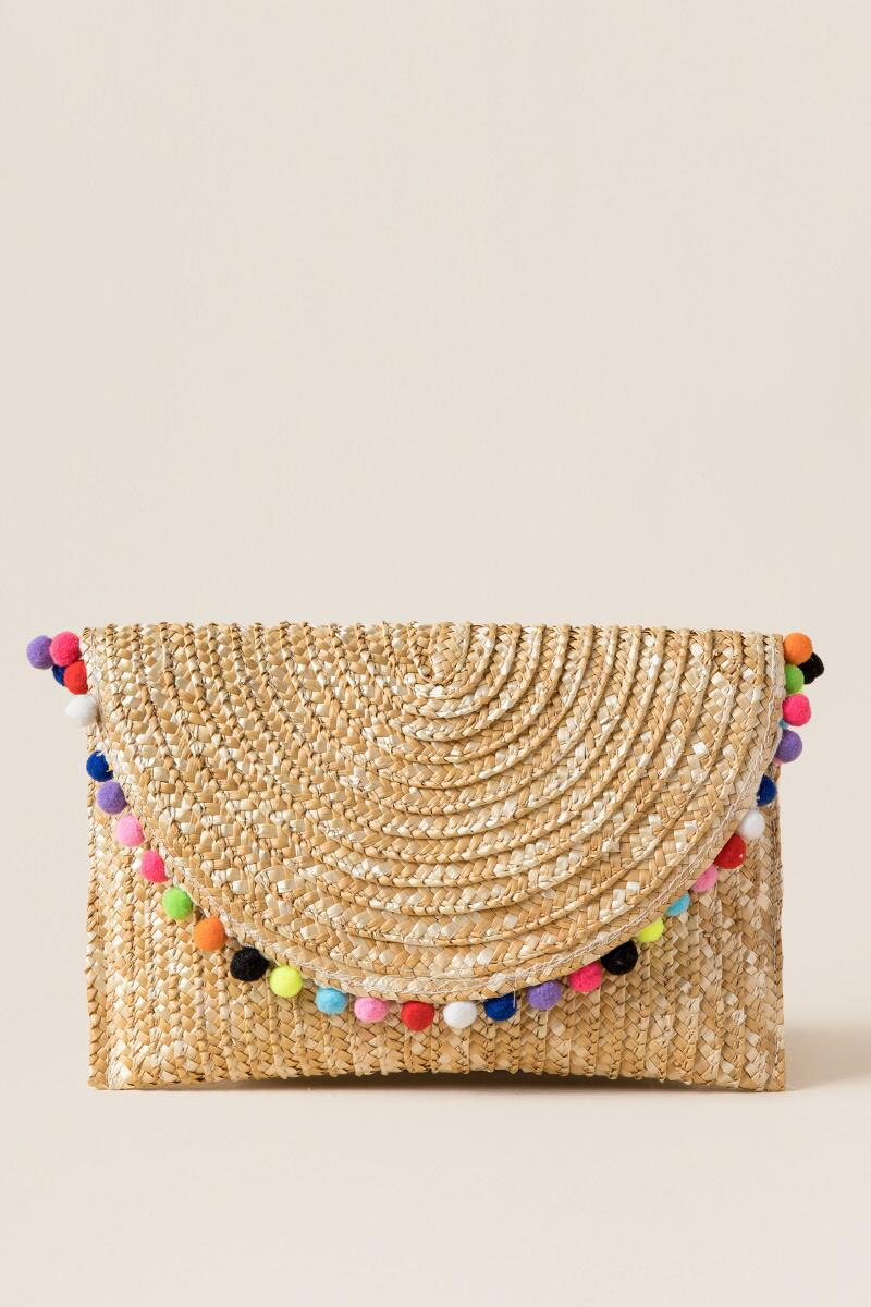 Woven clutch with pom poms