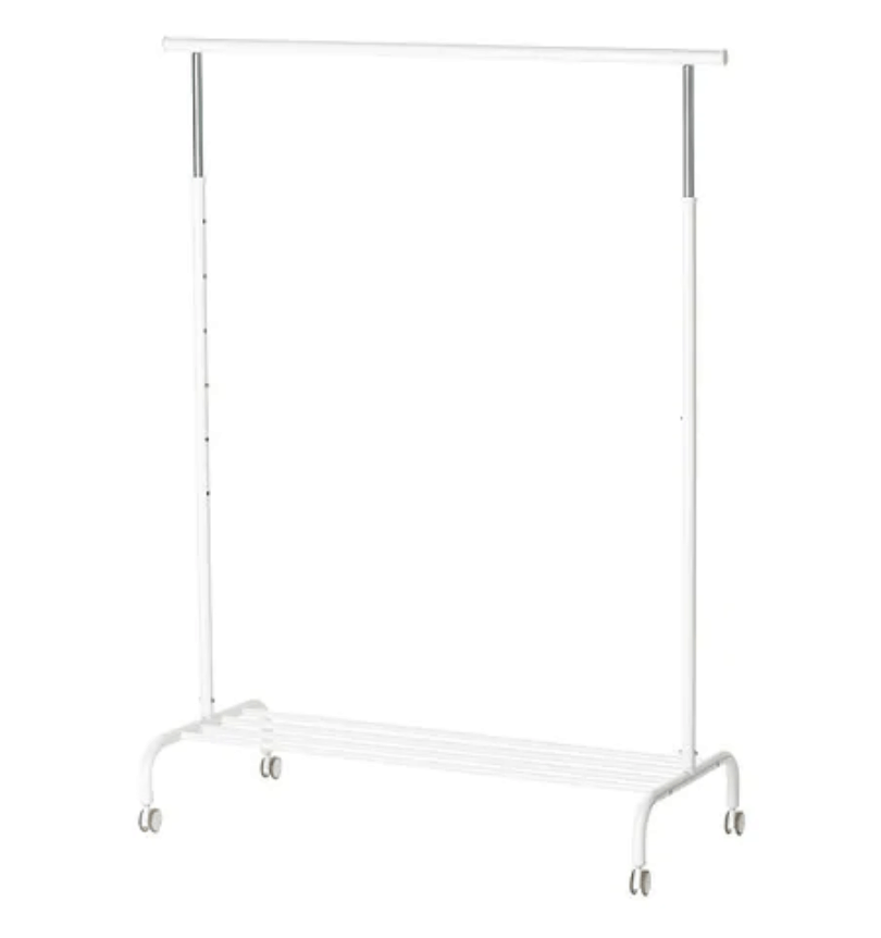 White IKEA metal clothing rack with wheels.