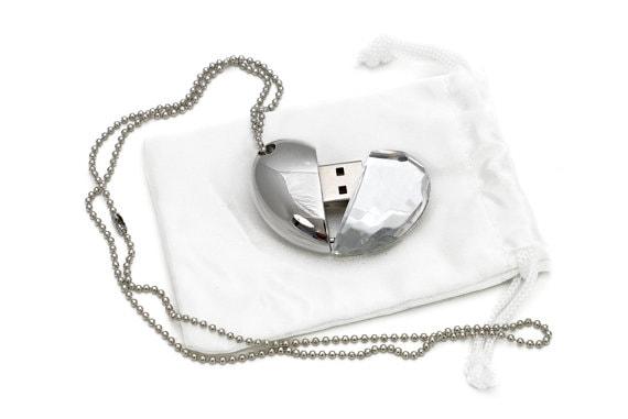 USB heart locket on white cloth