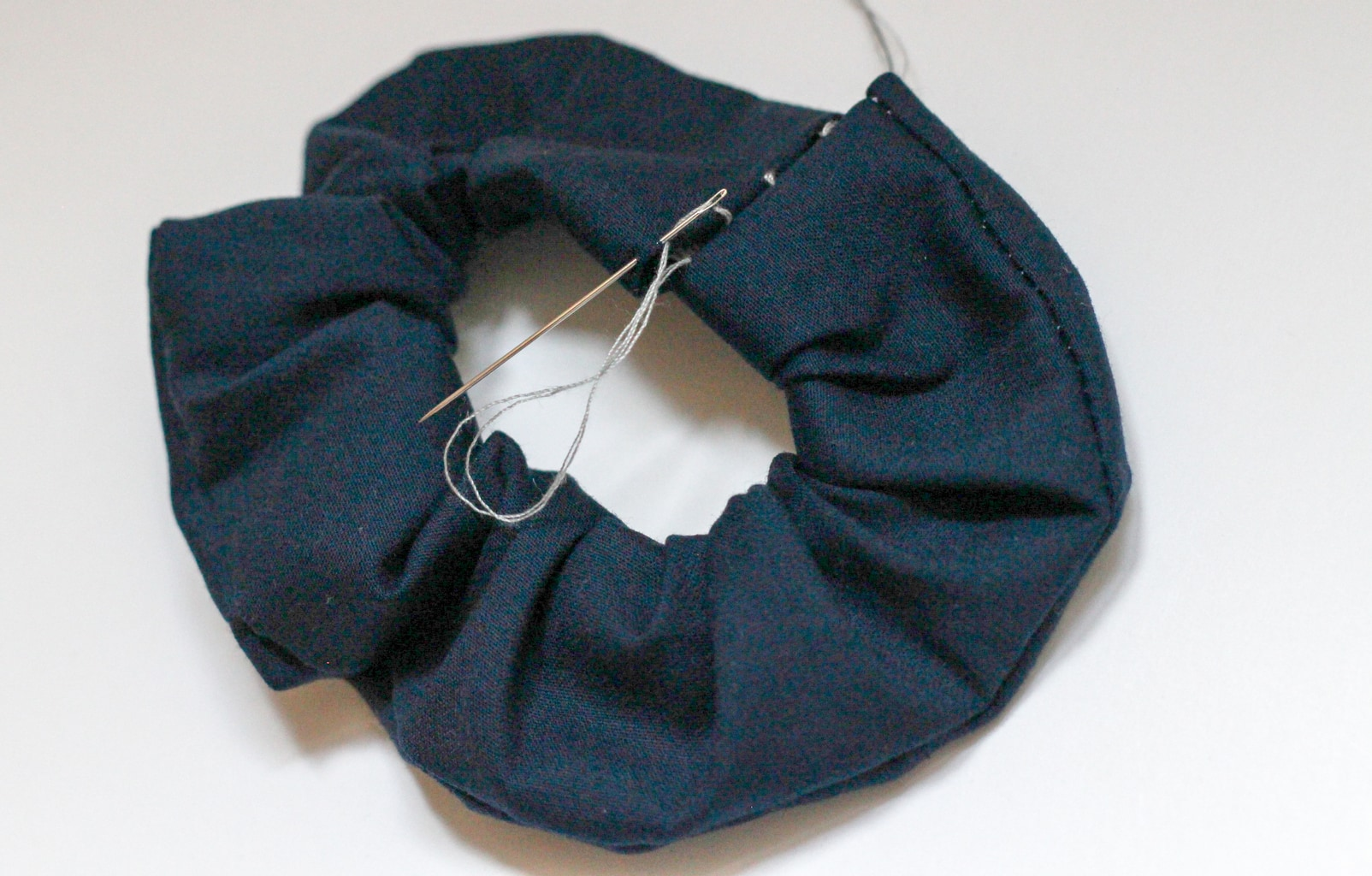 DIY scrunchies: Sew the ends of the scrunchie together with a needle and thread