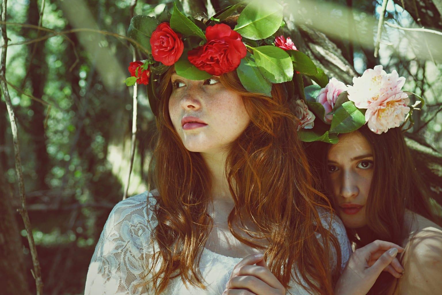 Two women wearing flower crowns