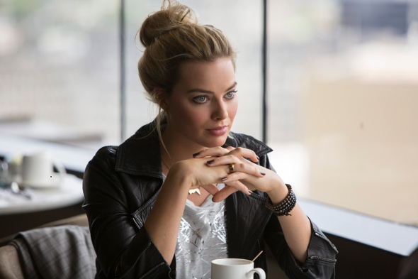 Margot Robbie in Focus wearing a leather jacket