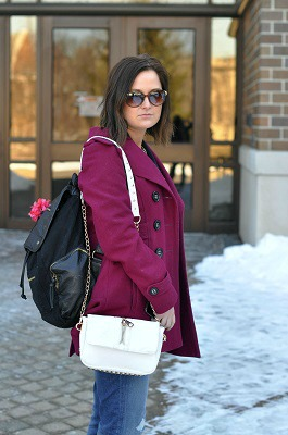 Jewel tone coat and white purse