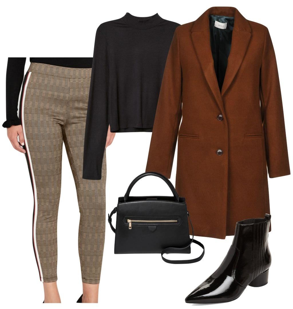 Jordyn Woods Outfit: black mock neck top, brown plaid side stripe pants, long brown coat, black top handle satchel handbag, and black patent ankle booties