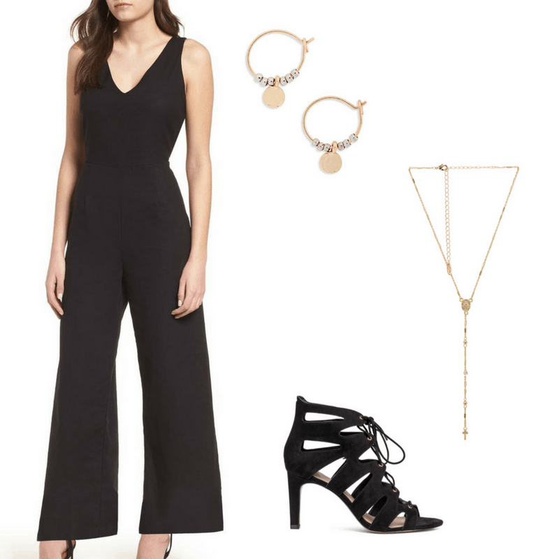 Graduation outfit idea with a jumpsuit: Black v-neck jumpsuit, black strappy heels, gold lariat necklace, gold and silver hoop earrings