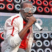 Kanye West wearing shutter shades, or Kanye Glasses