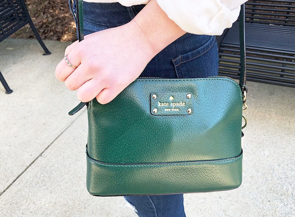 This emerald crossbody small Kate Spade purse adds a pop of color to this WVU fashionista's simple style.