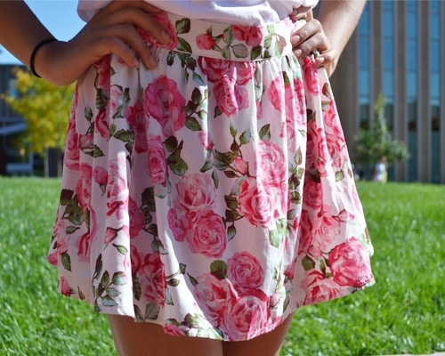 Kent state student wearing a floral skirt