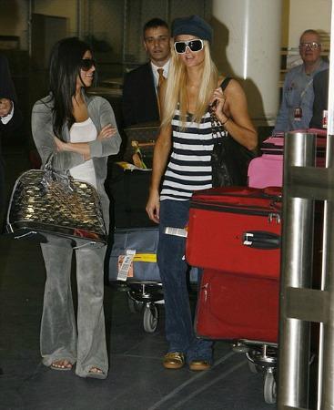 Kim Kardashian wearing a gray juicy couture tracksuit