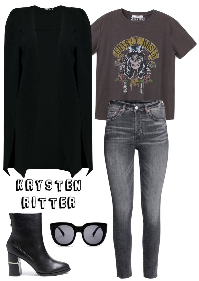 Krysten Ritter Outfit: black longline cape, gray rocker graphic t-shirt, gray jeans, black sunglasses, and black mid-calf booties